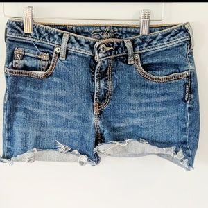 Silver ripped denim shorts